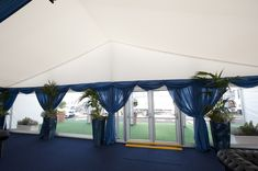 Our CQ stretch zip finish linings applied to a classic apex gable, with contrasting blue swags and window drapes.