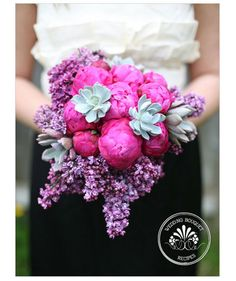 Bride holding hot pink peony bouquet