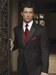 Black suit with burgundy vest & tie