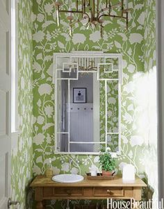 green & white botanical wallpaper + wood vanity