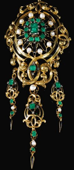 EMERALD, ENAMEL AND GEM SET BROOCH, 1870S Composed of gold foliate scroll work, set to the centre with a step-cut emerald and embellished with similarly and hexagonal-cut emeralds, natural pearls, rose diamonds, and black enamel, suspending three detachable pampilles, French assay and partial maker's marks.