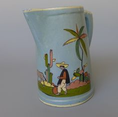 http://www.ebay.com/itm/Old-vintage-1940s-Mexican-pottery-blue-Tlaquepaque-pitcher-w-donkey-8-1-4-tall-/231314356058
