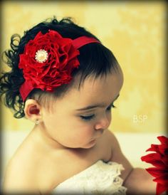 probably what my future kid will look like and I like this baby headband too.