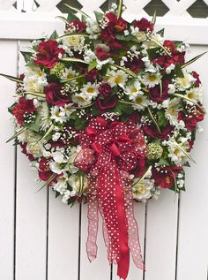 """My wreath design for summer and memorial day """"Roses are Red""""  May 2009 by Linda's Creations was sold on Ebay to a lady in New York."""