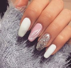 Love the feather. && you kno a glitter nail is always needed!!
