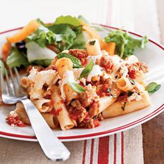 Baked Pasta with Sausage, Tomatoes, and Cheese: This easy, cheesy pasta recipe features ziti, turkey sausage, canned tomatoes, and fresh basil. It's a perfect pasta dish for busy weeknights.