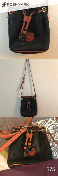 """Vintage Black Leather Dooney & Bourke Bucket Bag Can be used as cross-body or shoulder bag, approximately 8""""x8"""", good condition Dooney & Bourke Bags"""