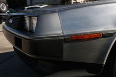 The DeLorean at the Garage 77 in Los Angeles Garage, Cars, Vehicles, Carport Garage, Autos, Garages, Car, Car, Automobile