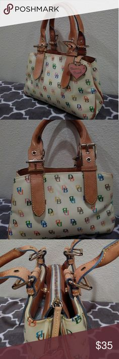 SALEDooney and Bourke Signature Satchel Beutiful fun D&B satchel. In great used condition. Make me an offer! Dooney & Bourke Bags Satchels