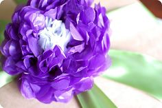 Tissue paper flower - I have so much wrinkled tissue paper lying around, just iron it out and make a few of these!
