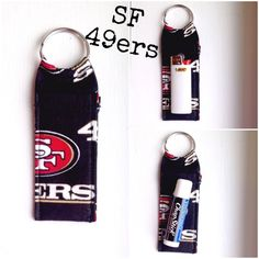 """SF 49ers NFL Print Chapstick Keychain NEW SF 49ers NFL Print Chapstick Keychain Fits Mini Bic Lighters~and Flash Drives Size 4"""" x 1  1/2"""" Smoke Free Home Chapstick/Lighter NOT Included ✨Pattern placement varies✨ All Keychains are made with high quality material from a smoke free home Interface Metal Keyring Made in Vera Bradley Accessories Key & Card Holders"""