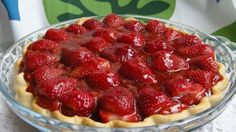 Half of this pie's strawberries are arranged in a baked pastry shell, and the other half are crushed and cooked until thick and bubbly. This lovely glaze is then poured over the whole berries in the pastry shell. Chill this pie for several hours and serve it with mounds of whipped cream.