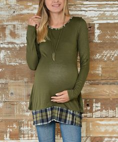 Rock the casual-chic look in a snap thanks to this layer-friendly tunic that features trendy plaid trim. A dash of stretch ensures all-day comfort.