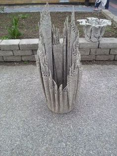 cloth soaked in concrete to make planters. Oh, the possibilities.
