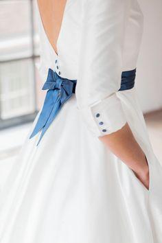 Shelly: tea- length wedding dress with petticoat and blue belt.. €1,550.00, via Etsy.