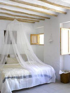 I like this. Love how the bedis simple, with jsut a FEW pillows--NOT lots of lace and tons of pillows and shams, etc. Just clean simply lines for ease and relaxation. Simple walls too to magnify that sense of serenity.