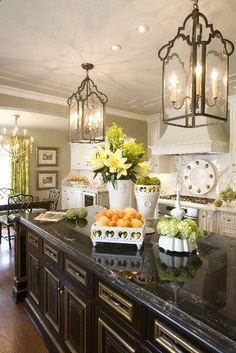 black cabinets,  nice contrast to neutral walls/counters would look good with black pane windows