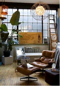 masculine leather w eclectic lighting n pieces aNd my Bird of Paradise!!!  Eames Lounger Chair