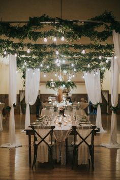 A January wedding with freshly fallen snow set in Hartland, Wisconsin. Fresh greens brought the outdoors in, while guests enjoyed a roaring fireplace and candlelit meal.