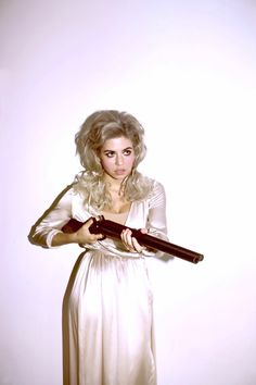 what's not to love about big hair and big guns? :)
