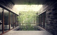 6-minimalist-homes-stacked-crisscrossed-masonry-volumes-8-courtyard.jpg