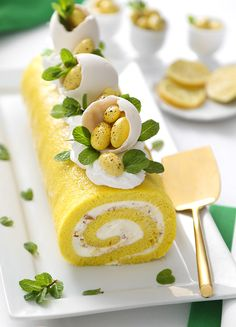 Celebrate the sunny flavors of spring with this limoncello infused sponge cake. It's filled with sweetened cream cheese frosting and a generous helping of crushed Sconza Lemoncello Chocolate Almonds. Fancy Desserts, Köstliche Desserts, Dessert Recipes, Plated Desserts, Lemon Desserts, Cake Roll Recipes, Lemon And Coconut Cake, Candied Almonds, Gateaux Cake