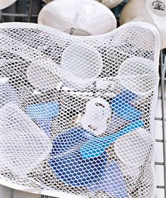 Laundry Bag as Dishwashing Aid  Keep mini Tupperware lids, baby-bottle caps, and other small items from falling through the dishwasher rack. You'll save time by no longer diving for treasure on the floor of the dishwasher.