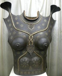 Stunning very unusual Indo Persian Mughal Indian  Khula Khud battle LADY warrior body iron covers . Near to similar lady chest plates were used  during war at India ,  Jhansi ( India ) during year 1855 to 1860 by Rani Laxmi Bai, the queen of JHANSI.