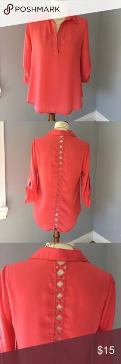 Coral top Coral top with open crisscross design on back.  I removed the tag at one point because it bothered me 🤷🏼‍♀️ I know I purchased this top at a local Miami boutique but do. It recall the brand.  The size is Medium. Tops Blouses