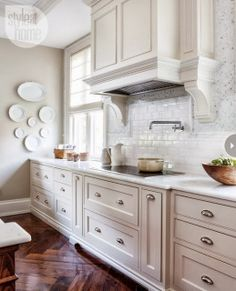 putty colored walls, light cabinets and loving that medium tone herringbone wood floor