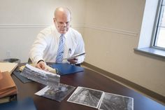 """Police close in on suspect in #ColdCase homicide. State police Trooper John F. Marshall, who oversees the cold case homicides for the Uniontown state police station, lays out the crime scene photos of the location where the body of Thomas Allan """"Brody"""" Miller was found. Brody was first reported missing on Sept. 23, 1980, by his wife, Nancy."""