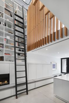 Robitaille Curtis stretches trapeze net across void at Atrium Townhome in Montreal Home Interior, Interior Design Kitchen, Interior Architecture, Plywood Wall Paneling, Home Living Room, Living Room Decor, Montreal, Atrium House, Glass Pocket Doors
