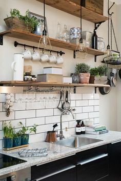 White and black kitchen with rustic open shelving