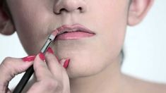 Clear, detailed video showing how to make thin upper lip appear fuller, and how to make lip color last.