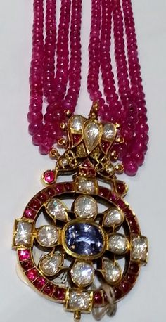 Ruby necklace & blue sapphire, burma rubies and diamond pendant. Mounted in 23K gold
