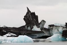 Icebergs covered in ash from the Grimsvotn volcano eruption, in the glacier lagoon at the base of Vatnajokull, Iceland.