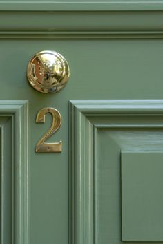 Front door painted in Calke Green No.34