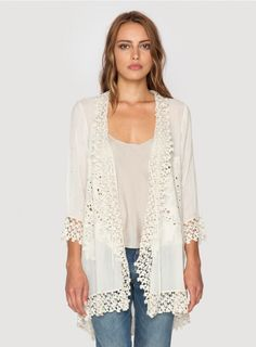 Blossom Jacket The Johnny Was BLOSSOM JACKET is a feminine layering piece! This light jacket, cut in flowy rayon georgette, features stunning open-work detailing along both the front and back, accented by crochet lace trim around the neckline, sleeves, and hem. Layer the BLOSSOM JACKET over a party dress for an added layer of warmth, or bring it to the beach - you'll find countless ways to wear this versatile jacket!  - Rayon Georgette - Open Draped Front with Tie, ¾ Length Sleeves…