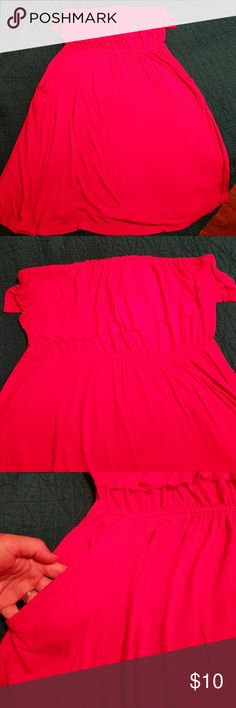 Hot pink strapless dress with pockets! This is such a cute, flirty summer dress! The material is soft and stretchy with an elastic waist and pockets. The top has a fold over ruffle for that little something extra. There are some strings from the ruffle as it has a raw hem. You could easily trim them if they bother you, but they aren't noticeable when on. Excellent condition. Dresses Strapless