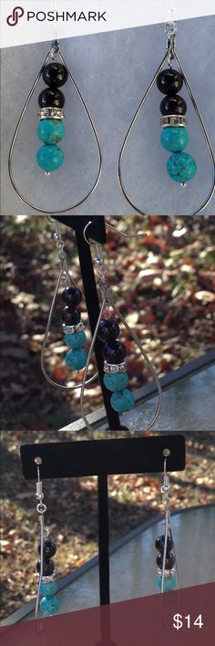 Garnet and Turquoise Magnesite Long Hoop Earrings These long and lovely earrings are made with natural sangria red garnet and turquoise magnesite. They also feature rhinestone studded accents. The hooks are sterling silver plated.   All PeaceFrog jewelry items are handmade by me! Take a look through my boutique for coordinating jewelry and more unique creations. PeaceFrog Jewelry Earrings