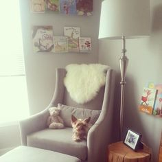 Murray's fave new spot in the house...reading nook in the #nursery #greatestchairever #westelm #babycanavan