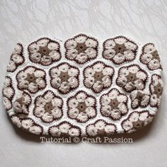 Free Crochet African Flower Purse pattern with tutorial to crochet the bag by using African Flower motifs. Sew it up with lining to complete the purse. – Page 2 of 2