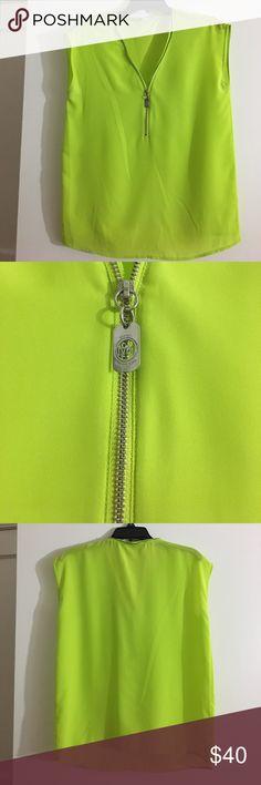 Michael Kors lime green blouse size small Michael Kors Lime Green sleeveless blouse size small with silver zipper detailing. MICHAEL Michael Kors Tops Blouses