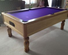 7ft Emperor bespoke UK pool table in European oak with a natural satin finish, tulip legs, black leather pockets and purple cloth. Shop here: http://www.snookerandpooltablecompany.com/pool-tables/uk-pool-tables/traditional-bespoke-uk-pool/emperor-uk-pool-table-in-oak-with-purple-cloth.html