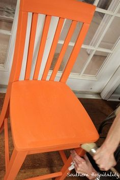 Beautiful chair in Barcelona Orange. Link also has a how-to on waxing over Chalk Paint™.