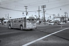 (1956) Long Beach Motor Bus 7109 is Heading Southbound on American Ave. While Crossing Willow St.