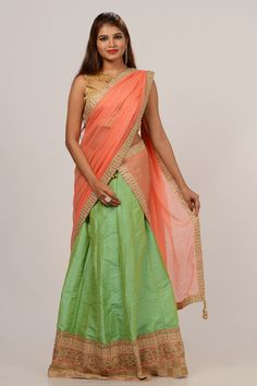 Lehenga by kalanjali #lehenga #blouse #dupatta#Mint green shade raw silk plain semi stitched lehenga is enhanced with amazing pearl-beads gold embroidered, embellished board border. Available matching blouse with growing peach georgette dupatta.