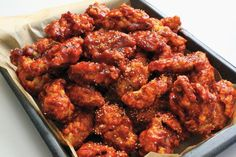 Double-fried Korean chicken wings stay crunchy for hours after cooking, while leaving the inside moist and tender. This recipe is based on the wings made in local fried chicken joints in Gwangju.
