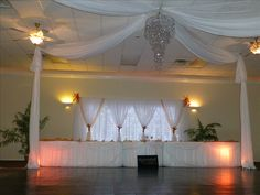 Head Tables, Led lighted backdrop with curtain panels and floral tiebacks. Gazebo dancefloor with chandelier. Uplights on head tables