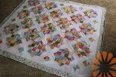 Piece N Quilt: Custom Machine Quilting a Scrappy Quilt by Natalia Bonner